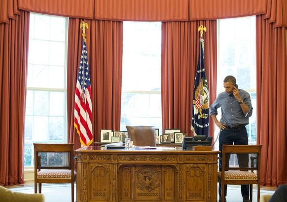 President Barack Obama talks on the phone in the Oval Office with Russian President Vladimir Putin about the situation in Ukraine, March 1, 2014. The White House said Obama and Putin spoke by phone for 90 minutes, their second phone call in the past eight days over Ukraine, an escalating crisis that is presenting a new challenge to already strained U.S.-Russian relations. REUTERS/Official White House Photo/Pete Souza/Handout   (UNITED STATES - Tags: POLITICS TPX IMAGES OF THE DAY) FOR EDITORIAL USE ONLY. NOT FOR SALE FOR MARKETING OR ADVERTISING CAMPAIGNS. THIS IMAGE HAS BEEN SUPPLIED BY A THIRD PARTY. IT IS DISTRIBUTED, EXACTLY AS RECEIVED BY REUTERS, AS A SERVICE TO CLIENTS