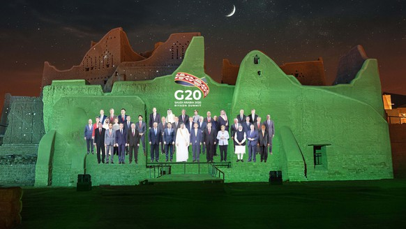 epa08831516 A handout photo made available by G20 Riyadh Summit shows a virtual family photo of G20 leaders projected on the walls of At-Turaif District in Ad-Diriyah, Riyadh, Saudi Arabia (issued 20 November 2020). The G20 Leaders' Summit will be held virtually on 21 and 22 November and is organized by Saudi Arabia's current G20 Presidency.  EPA/G20 RIYADH SUMMIT HANDOUT  HANDOUT EDITORIAL USE ONLY/NO SALES