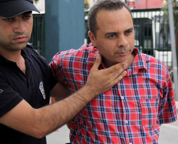 epa05431943 Turkish police with an arrested Turkish soldier at police headquarter in Mersin, Turkey, 19 July 2016. Turkish Prime Minister Yildirim reportedly said that the Turkish military was involved in an attempted coup d'etat. Turkish President Recep Tayyip Erdogan has denounced the coup attempt as an 'act of treason' and insisted his government remains in charge. Some 104 coup plotters were killed, 90 people - 41 of them police and 47 are civilians - 'fell martrys', after an attempt to bring down the Turkish government, the acting army chief General Umit Dundar said in a televised appearance.who were killed in a coup attempt on 16 July, during the funeral, in Istanbul, Turkey, 17 July 2016. Turkish Prime Minister Yildirim reportedly said that the Turkish military was involved in an attempted coup d'etat. Turkish President Recep Tayyip Erdogan has denounced the coup attempt as an 'act of treason' and insisted his government remains in charge. Some 104 coup plotters were killed, 90 people - 41 of them police and 47 are civilians - 'fell martrys', after an attempt to bring down the Turkish government, the acting army chief General Umit Dundar said in a televised appearance.  EPA/STR