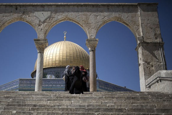 Muslim women gather on the stairs leading to to the Golden Dome of the Rock Mosque in the Al Aqsa Mosque compound in Jerusalem's Old City, Wednesday, April 30, 2014. Al Aqsa Mosque compound is one of the holiest site for Muslims. (AP Photo/Ariel Schalit)