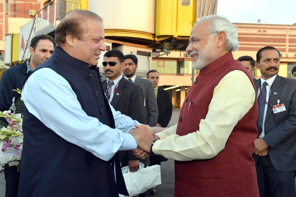 epaselect epa05080693 A handout photograph released by the Indian Press Information Bureau (PIB) on 25 December 2015 of Indian Prime Minister Narendra Modi (R) being welcomed by the Prime Minister of Pakistan, Nawaz Sharif (L), at the airport in Lahore, Pakistan, 25 December 2015. Modi arrived in Lahore on a surprise stopover 25 December in the first visit by an Indian prime minister to Pakistan since 2004. India and Pakistan have had troubled ties in past decades over border disputes and terrorism accusations. The South Asian neighbours this month agreed to resume stalled peace talks.  EPA/PRESS INFORMATION BUREAU/HANDOUT  HANDOUT EDITORIAL USE ONLY/NO SALES
