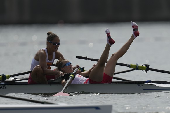 Patricia Merz and Frederique Rol of Switzerland react after competing in the lightweight women's rowing double sculls final at the 2020 Summer Olympics, Thursday, July 29, 2021, in Tokyo, Japan. (AP Photo/Lee Jin-man) Patricia Merz,Frederique Rol
