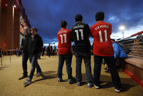 """Britain Football Soccer - Liverpool v Manchester United - Premier League - Anfield - 17/10/16 General view of Liverpool fans outside the stadium before the match Action Images via Reuters / Carl Recine Livepic EDITORIAL USE ONLY. No use with unauthorized audio, video, data, fixture lists, club/league logos or """"live"""" services. Online in-match use limited to 45 images, no video emulation. No use in betting, games or single club/league/player publications. Please contact your account representative for further details."""