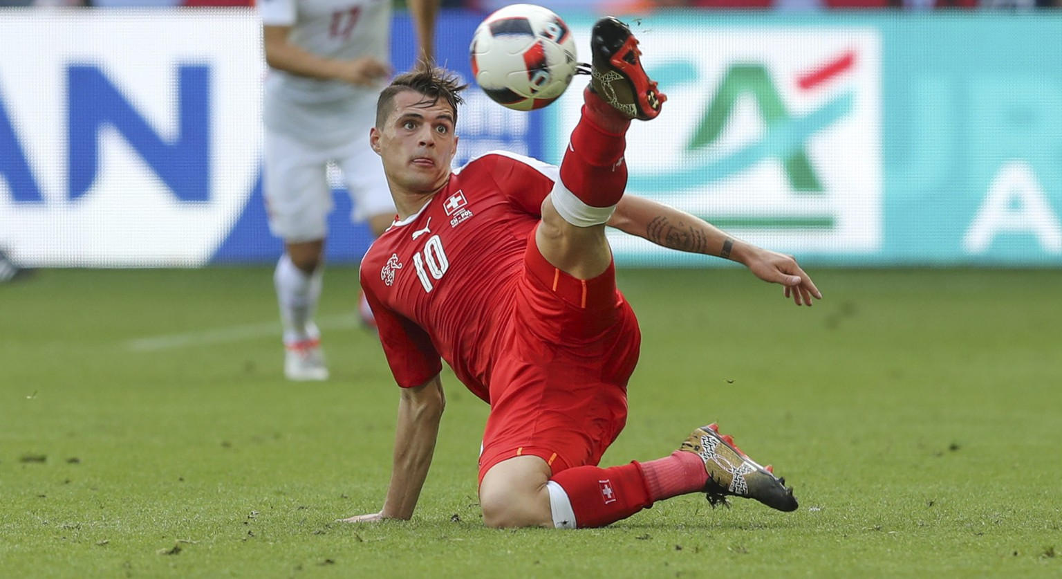 Switzerland's Granit Xhaka eyes the ball during the Euro 2016 round of 16 soccer match between Switzerland and Poland, at the Geoffroy Guichard stadium in Saint-Etienne, France, Saturday, June 25, 2016. (AP Photo/Thanassis Stavrakis)