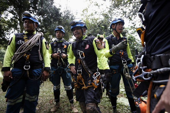 epa06870502 Thai rescue personnels prepare to search for chimneys for a drilling option during the ongoing rescue operations for the child soccer team and their assistant coach, at a mountain forest near Tham Luang cave in Khun Nam Nang Non Forest Park, Chiang Rai province, Thailand, 07 July 2018. Operations are underway to safely bring out the 13 members of youth soccer team including their assistant coach who have been trapped in Tham Luang cave since 23 June 2018.  EPA/RUNGROJ YONGRIT