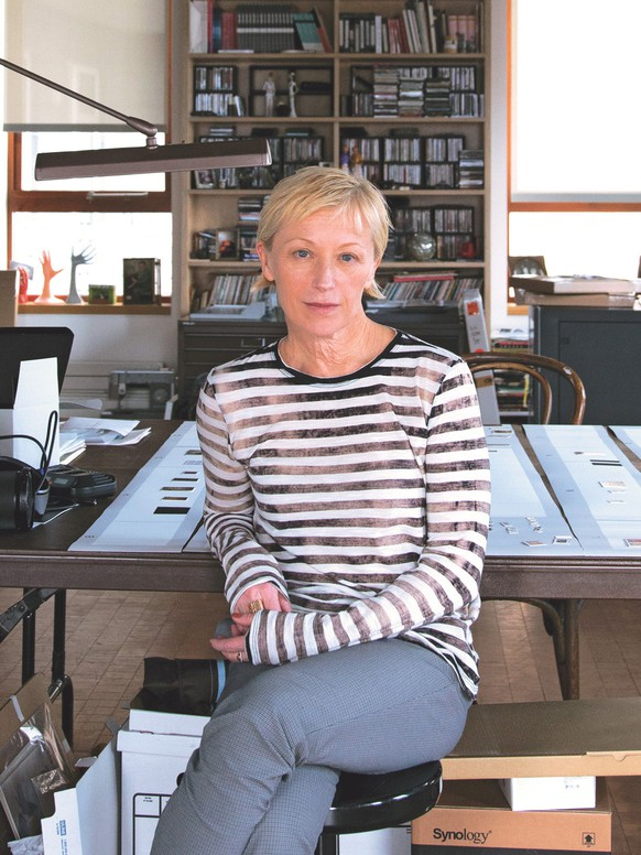 This photo provided by Abrams shows artist Cindy Sherman in her studio among props and costumes from her work, included in the book,
