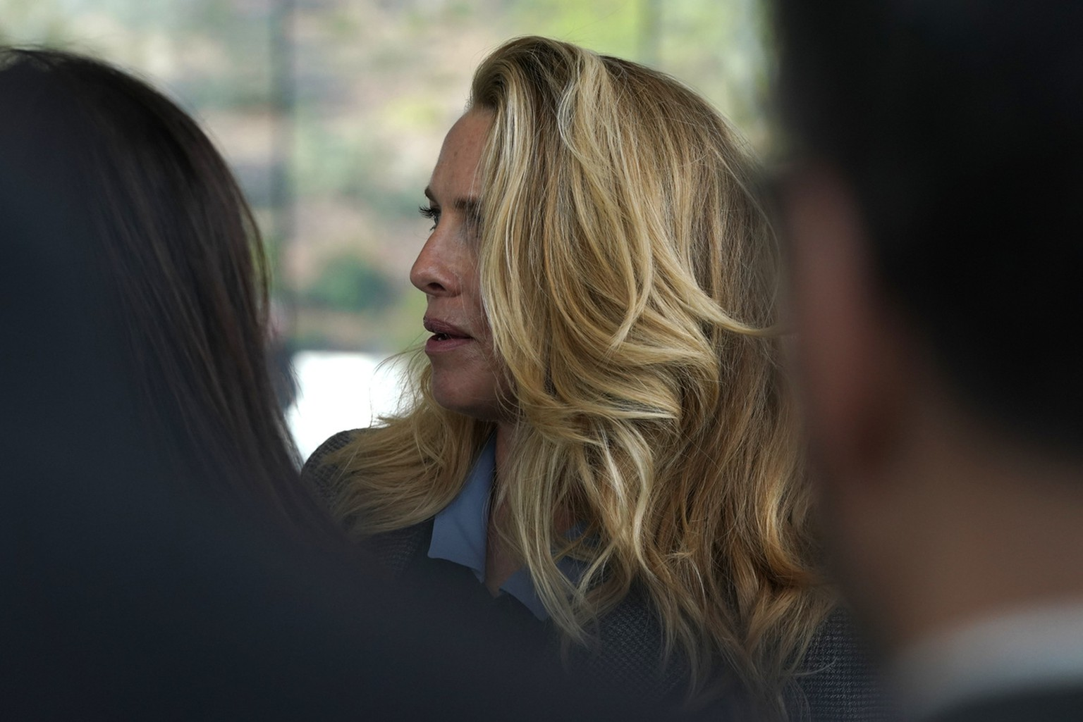 Laurene Powell, the widow of Steve Jobs, waits to enter the Steve Jobs Theater for an event to announce new products Monday, March. 25, 2019, in Cupertino, Calif. (AP Photo/Tony Avelar)