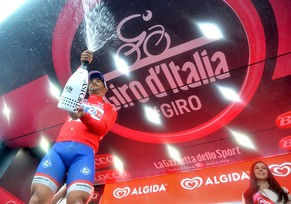 epa04204104 French rider Nacer Bouhanni of Fdj.fr team celebrates on the podium after winning the fourth stage, 112 km from Giovinazzo to Bari, of the 97th Giro d'Italia cycling race, in Bari, Italy, 13 May 2014.  EPA/LUCA ZENNARO