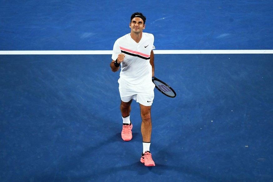 epa06450002 Roger Federer of Switzerland celebrates after winning his second round match against Jan-Lennard Struff of Germany at the Australian Open Grand Slam tennis tournament in Melbourne, Australia, 18 January 2018.  EPA/LUKAS COCH AUSTRALIA AND NEW ZEALAND OUT