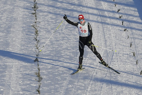 Winner Tim Hug of Switzerland skis to finish during the FIS Nordic Combined World Cup in Chaikovsky, about 1,000 km (621 miles) east of Moscow, Russia, Saturday, Jan. 4, 2014. (AP Photo/Pavel Golovkin)