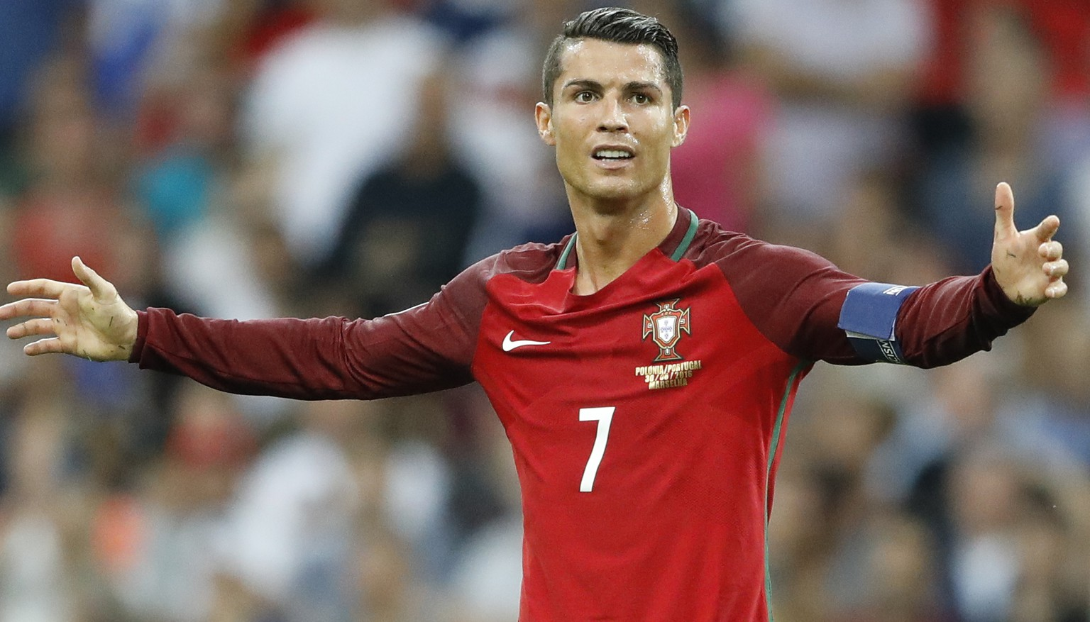 Portugal's Cristiano Ronaldo opens his arms as he calls for referee's attention during the Euro 2016 quarterfinal soccer match between Poland and Portugal, at the Velodrome stadium in Marseille, France, Thursday, June 30, 2016. (AP Photo/Frank Augstein)