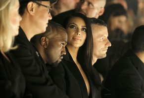 TV personality Kim Kardashian and rapper Kanye West attend the Israeli-American designer Alber Elbaz Spring/Summer 2015 women's ready-to-wear collection for fashion house 