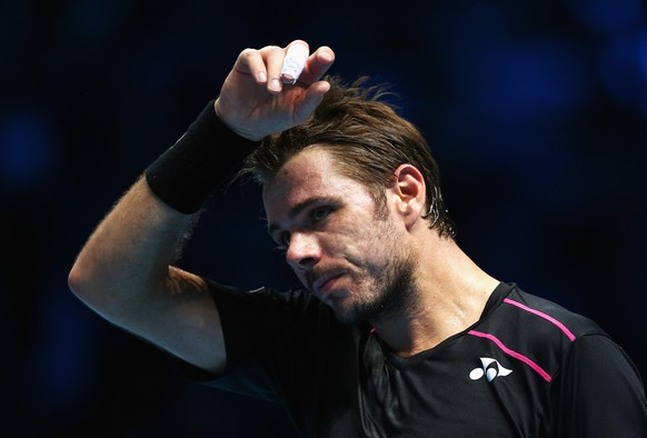 LONDON, ENGLAND - NOVEMBER 16:  Stanislas Wawrinka of Switzerland wipes his brow in his men's singles match against Rafael Nadal of Spain during day two of the Barclays ATP World Tour Finals at O2 Arena on November 16, 2015 in London, England.  (Photo by Clive Brunskill/Getty Images)