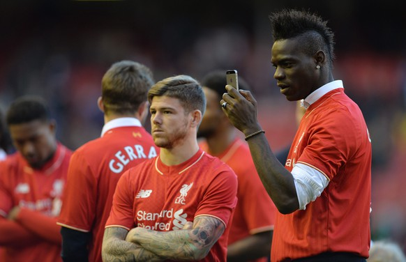 epa04752105 Liverpool's Mario Balotelli (R) and Liverpool's Alberto Moreno (C) react as they walk around the pitch after playing the last home game of the season during the English Premier League soccer match between Liverpool and Crystal Palace at the Anfield in Liverpool, Britain, 16 April 2015. Liverpool's captain Steven Gerrard makes his final home appearance before leaving the club in the summer to play for Los Angeles Galaxy in the MLS.  EPA/PETER POWELL DataCo terms and conditions apply  http://www.epa.eu/files/Terms%20and%20Conditions/DataCo_Terms_and_Conditions.pdf