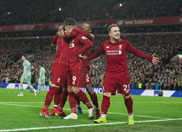 epa07253385 Liverpool's Roberto Firmino celebrates scoring the sixth goal making the score 5-1 during the English Premier League soccer match between Liverpool and Arsenal at the Anfield in Liverpool, Britain, 29 December 2018.  EPA/PETER POWELL EDITORIAL USE ONLY. No use with unauthorized audio, video, data, fixture lists, club/league logos or 'live' services. Online in-match use limited to 120 images, no video emulation. No use in betting, games or single club/league/player publications