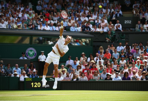LONDON, ENGLAND - JULY 02: Roger Federer of Switzerland serves during his Gentlemens Singles Second Round match against Sam Querry of the United States during day four of the Wimbledon Lawn Tennis Championships at the All England Lawn Tennis and Croquet Club on July 2, 2015 in London, England. (Photo by Ian Walton/Getty Images)