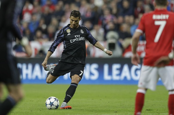Real Madrid's Cristiano Ronaldo kicks the ball during the Champions League quarterfinal first leg soccer match between FC Bayern Munich and Real Madrid, in Munich, Germany, Wednesday, April 12, 2017. (AP Photo/Matthias Schrader)