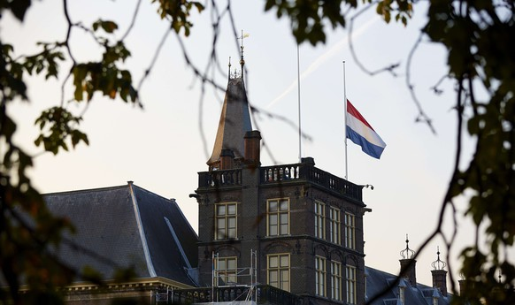 A Dutch national flag flies at half mast on the Dutch parliament in The Hague, early on July 18, 2014, after a Malaysia Airlines Boeing 777 carrying 298 people, mostly Dutch citizens, that departed from Amsterdam to Kuala Lumpur crashed in the Ukraine near the Russian border. Flight MH17 went down in strife-torn eastern Ukraine on Thursday. US officials said MH17 was shot down by a surface-to-air missile, a possible casualty of a violent rebellion by pro-Russian insurgents.  AFP PHOTO / ANP   MARTIJN BEEKMAN ***Netherlands out***