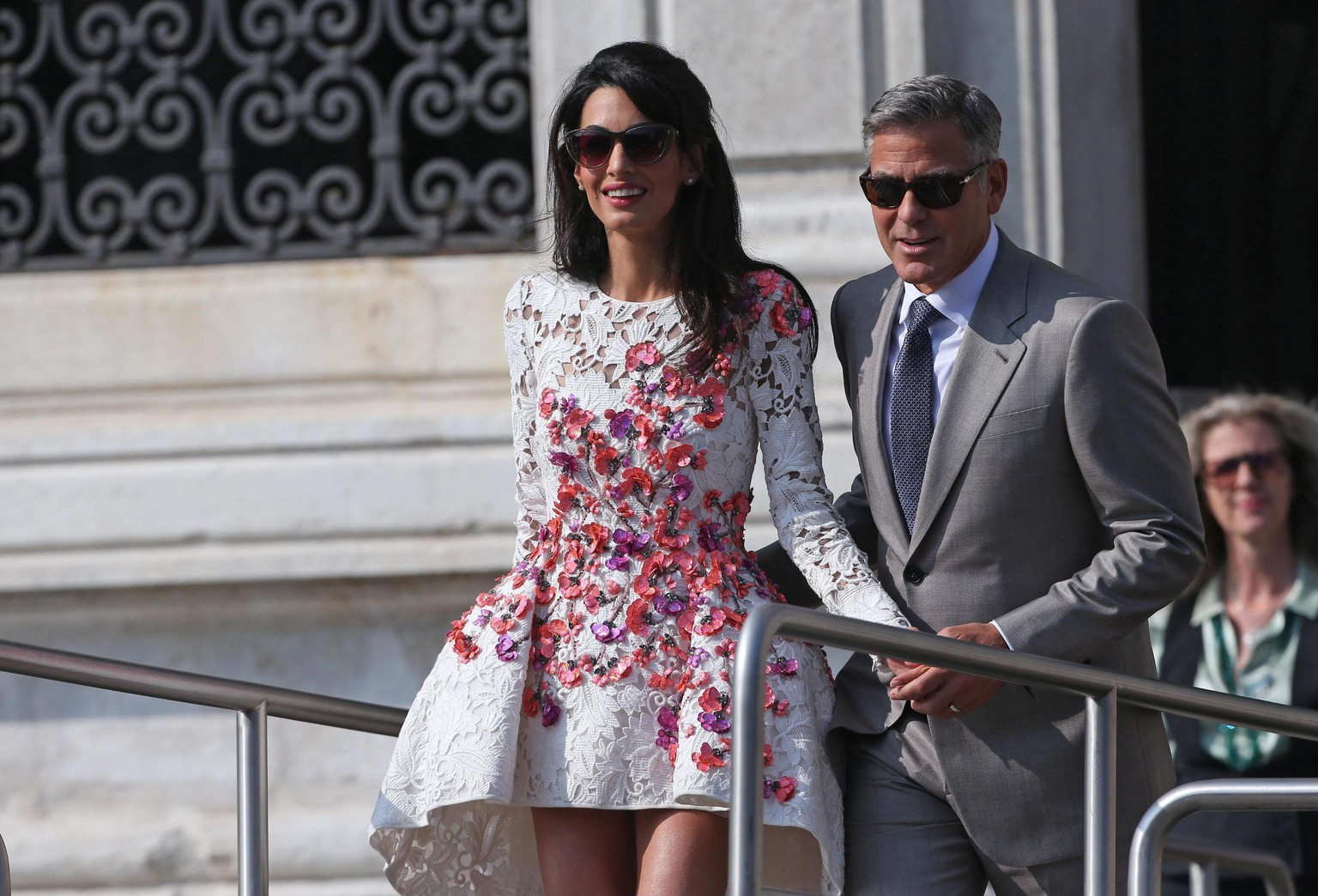 epa04421642 Newlywed couple, US actor George Clooney (R) and his wife Amal Alamuddin (C) get on board of a taxi boat, in Venice, Italy, 28 September 2014. Clooney and Alamuddin got married the day before at the Aman Resort hotel.  EPA/ALESSANDRO DI MEO
