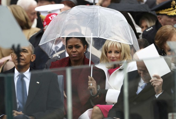 First Lady Michelle Obama (L) and Dr. Jill Biden look on during inauguration ceremonies swearing in Donald Trump as the 45th president of the United States on the West front of the U.S. Capitol in Washington, U.S., January 20, 2017. REUTERS/Carlos Barria