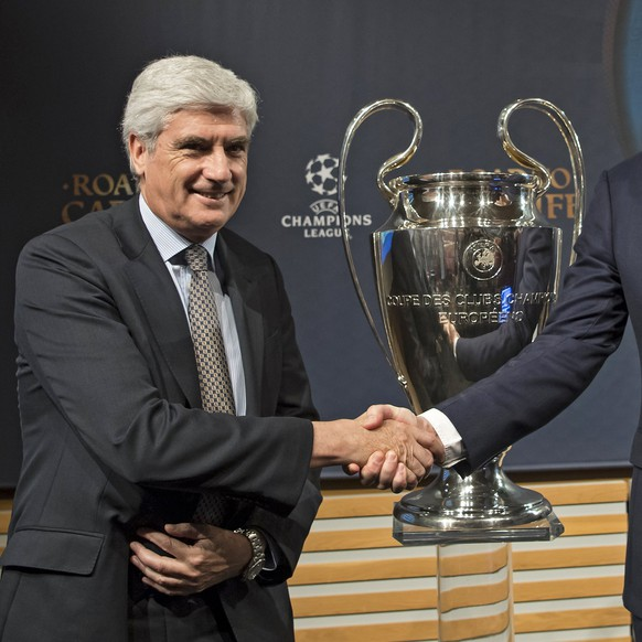 epa05854089 Atletic Bilbao Managing Director Clemente Villaverde (L) And Leicester City Football Operations Director Andrew Neville (R) shake hands next to the Champions League trophy following the quarter-final draw of the UEFA Champions League 2016/17, at the UEFA headquarters in Nyon, Switzerland, 17 March 2017. Atletico Madrid will face Leicester City in the quarter-finals.  EPA/JEAN-CHRISTOPHE BOTT