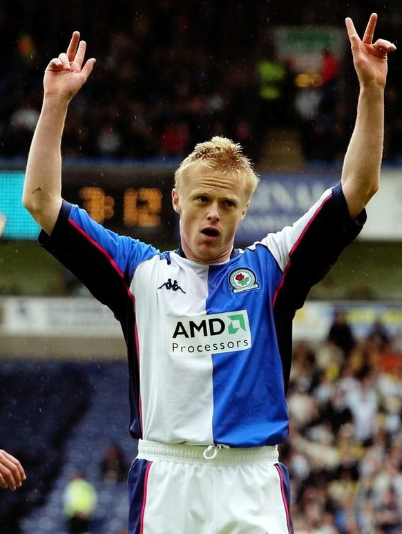 Blackburn Rovers' Damien Duff (R) celebrates his opening goal against West Bromich Albion, during their FA Barclaycard Premiership match at Blackburn's Ewood Park ground Saturday May 3 2003. EPA PHOTO PA Gareth Copley