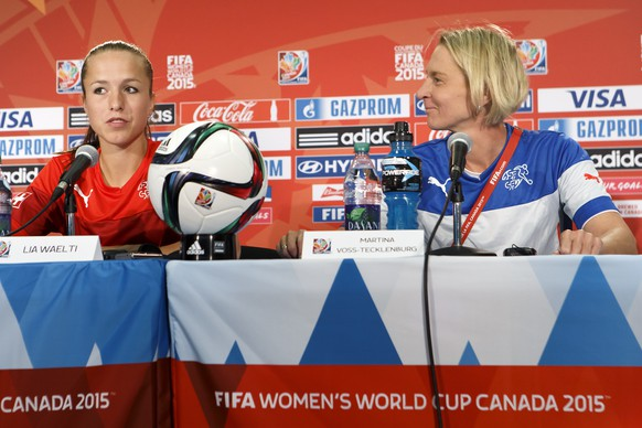 Switzerland's Lia Waelti, left, sitting next to Switzerland's head coach Martina Voss-Tecklenburg, right, from Germany, speaks to the media, during a press conference one day before the soccer match against Cameroon at the FIFA Women's World Cup Canada 2015, at the Commonwealth Stadium in Edmonton, Canada, Monday, June 15, 2015. The Switzerland national soccer team prepare its third match of the FIFA Women's World Cup Canada 2015. (KEYSTONE/Salvatore Di Nolfi)