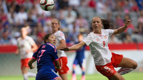 Japan's Yuki Ogimi, left, and Switzerland's Lia Waelti watch the ball during first half FIFA Women's World Cup soccer action in Vancouver, British Columbia, on Monday June 8, 2015. (Darryl Dyck(/The Canadian Press via AP) MANDATORY CREDIT