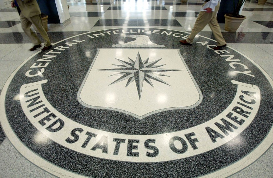 FILE - DECEMBER 9, 2014: It was reported that Senate Intelligence Committee chair U.S. Senator Dianne Feinstein (D-CA) is releasing details of a report reviewing the CIA's use of torture of terrorist suspects in the wake of the Sept. 11, 2001 attacks. LANGLEY, VA - JULY 9: The CIA symbol is shown on the floor of CIA Headquarters, July 9, 2004 at CIA headquarters in Langley, Virginia. Earlier today the Senate Intelligence Committee released its report on the numerous failures in the CIA reporting of alleged Iraqi weapons of mass destruction.  (Photo by Mark Wilson/Getty Images)