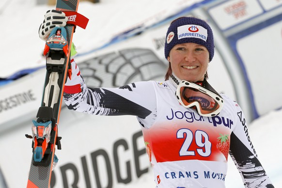 Andrea Fischbacher of Austria celebrates winning the women's FIS Alpine Skiing World Cup Downhill race on her way to the podium in the Swiss resort of Crans Montana March 2, 2014.   REUTERS/Ruben Sprich   (Switzerland - Tags: SPORT SKIING)