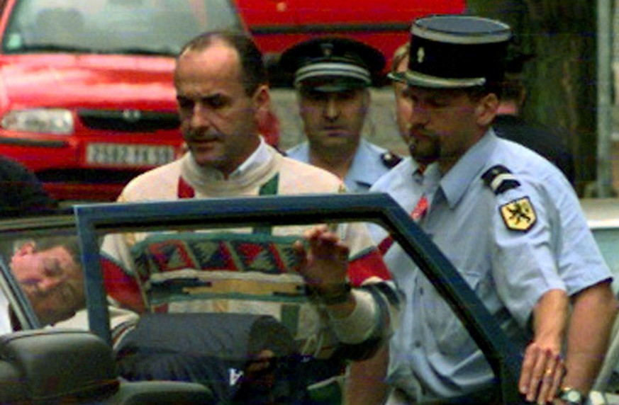 Festina cycling team director Bruno Roussel leaves in a police car the Lille court of Justice, northern France  Friday July 24, 1998, after giving his version of events regarding the investigation on Festina riders who were thrown out of the Tour de France for the possible use of illegal doping substances. The Festina team was expelled from the race after Roussel said from jail he had supplied them with illegal doping substances.  (KEYSTONE/AP Photo/Michel Spingler)