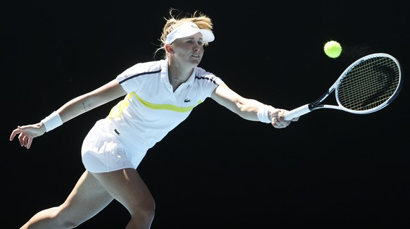 Switzerland's Jil Teichmann makes a forehand return to United States' Coco Gauff during their first round match at the Australian Open tennis championship in Melbourne, Australia, Tuesday, Feb. 9, 2021.(AP Photo/Hamish Blair)