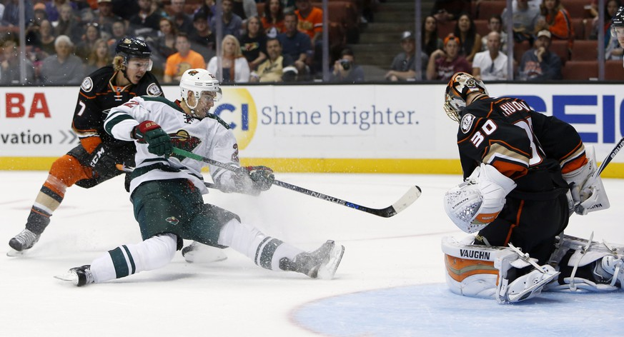 Anaheim Ducks Hampus Lindholm, left, can't stop Minnesota Wild's Nino Niederreiter (22) from scoring a goal past Anaheim Ducks goalie Anton Khudobin (30) in the first period of an NHL hockey game in Anaheim, Calif., Sunday, Oct. 18, 2015. (AP Photo/Christine Cotter)