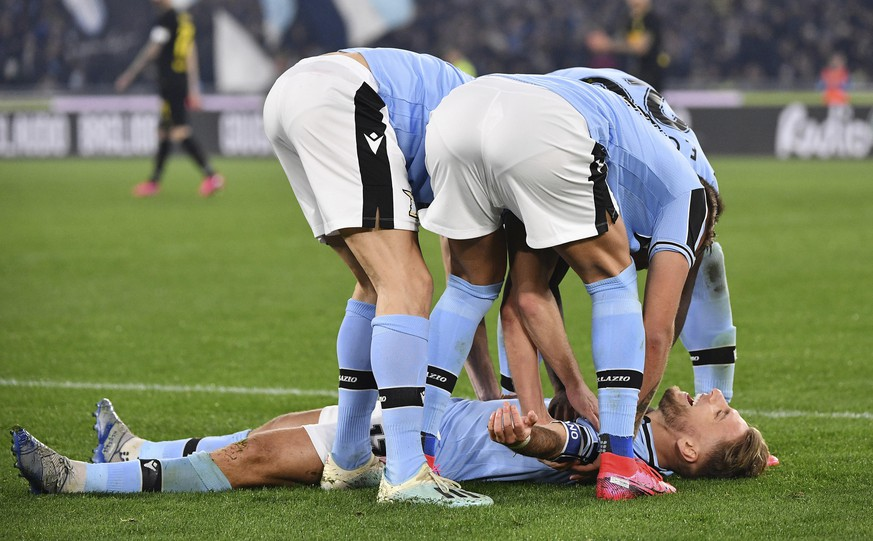 Lazio's Ciro Immobile, on the ground, celebrates with his teammates after he scored his side's first goal during the Serie A soccer match between Lazio and inter Milan, at Rome's Olympic stadium, Sunday, Feb. 16, 2020. (Alfredo Falcone/LaPresse via AP)