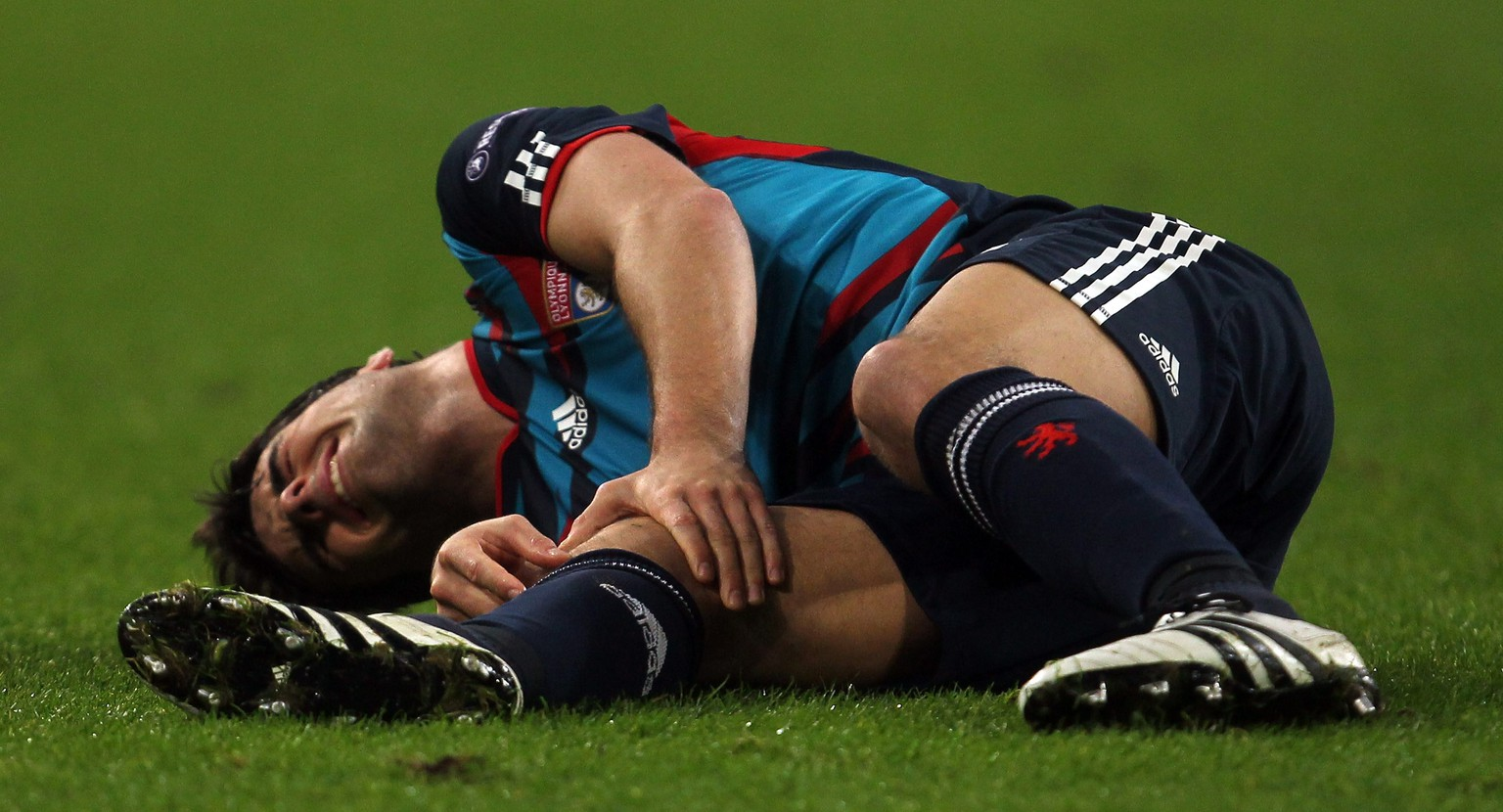 GELSENKIRCHEN, GERMANY - NOVEMBER 24:  Yoann Gourcuff of Lyonnais lies injured on the pitch during the UEFA Champions League group B match between FC Schalke 04 and Olympique Lyonnais at Veltins Arena on November 24, 2010 in Gelsenkirchen, Germany.  (Photo by Lars Baron/Bongarts/Getty Images)