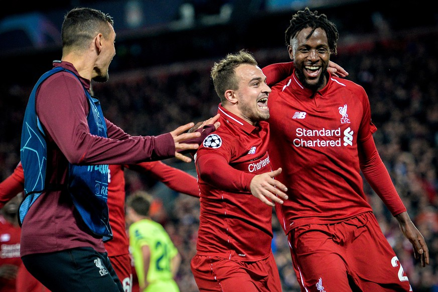 epa07554631 Liverpool's Divock Origi (R) celebrates with his teammate Xherdan Shaqiri (C) after scoring the 4-0 goal during the UEFA Champions League semi final second leg soccer match between Liverpool FC and FC Barcelona at Anfield stadium in Liverpool, Britain, 07 May 2019.  EPA/PETER POWELL