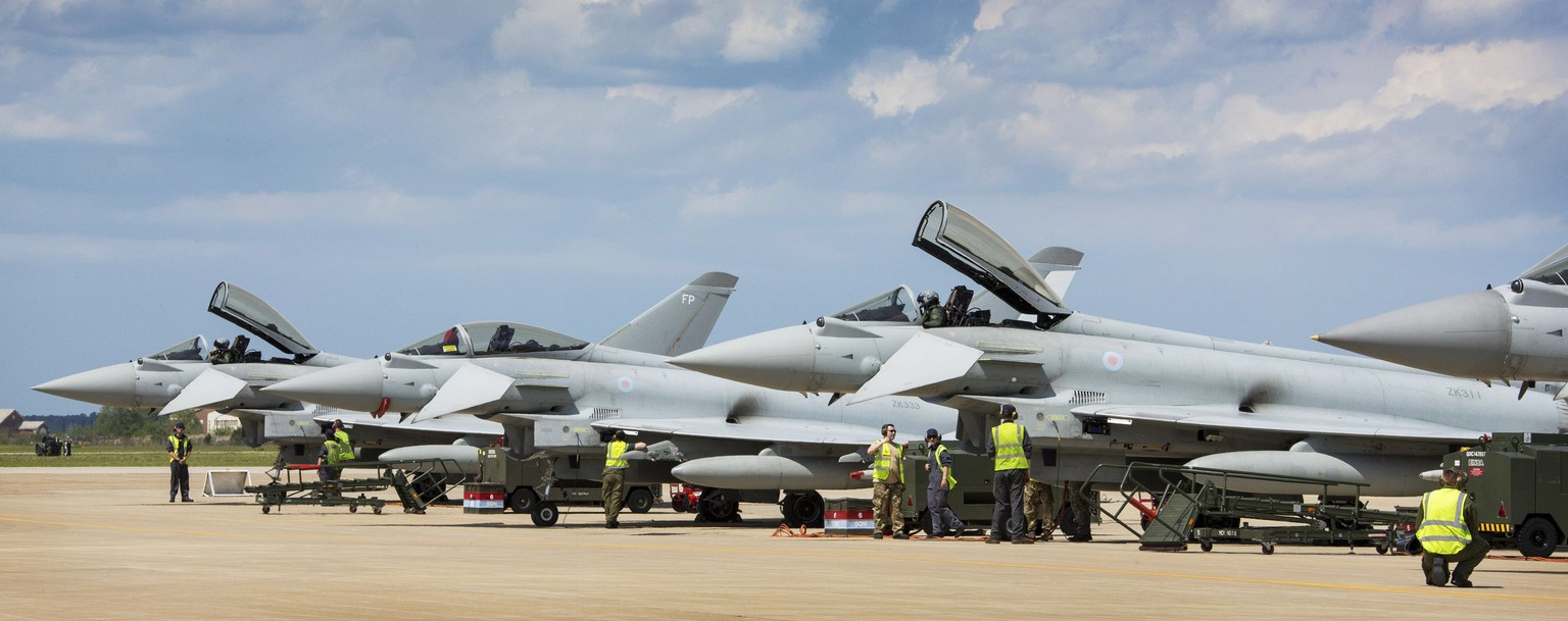 epa05919596 A handout photo made available on 21 April 2017 by the British Ministry of Defence (MOD) showing British Royal Air Force Typhoons of 1 Squadron, RAF Lossiemouth, prepare for Exercise Atlantic Trident 17 at Langley Air Force Base, Virginia, USA, on 17 April 2017. The MOD state that RAF Typhoons of 1 Sqn have joined two other NATO air forces at Langley Air Force Base, Virginia, for one of the world's biggest air combat exercises. Exercise Atlantic Trident 17 will be a test of skill, speed and communication for the air and ground crews of the RAF, US Air Force and Armée de l'Air, the French Air Force. The Eurofighter Typhoon, Lockheed Martin F-22 Raptor and Dassault Rafale will be joined by the Lockheed Martin F-35 Lightning.  EPA/SGT RALPH MERRY / BRITISH MINISTRY OF DEFENCE / HANDOUT MANDATORY CREDIT SGT RALPH MERRY: ROWN COPYRIGHT HANDOUT EDITORIAL USE ONLY/NO SALES