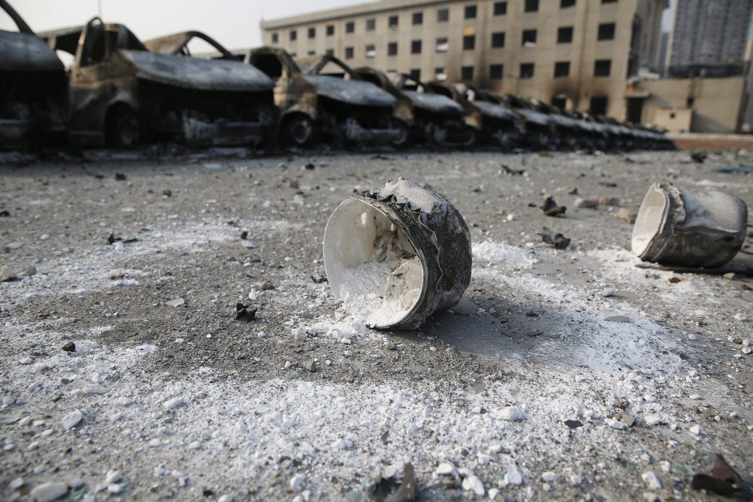 epa04884627 Unidentifiable industrial goods at the explosion site in the aftermath of a huge explosion that rocked the port city of Tianjin, China, 15 August 2015. Explosions and a fireball at a chemical warehouse killed at least 85 people in the north-eastern Chinese port city of Tianjin late on 12 August. New explosions rocked a chemical warehouse in northern China as police ordered residents to evacuate buildings within a three-kilometre radius, state media said on 15 August.  EPA/WU HONG