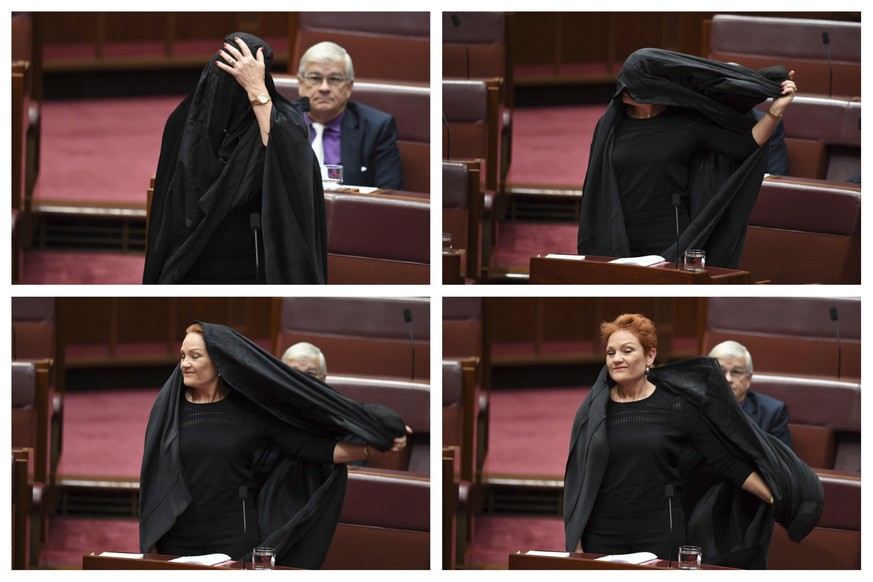 In this combination of photos Sen. Pauline Hanson takes off a burqa she wore into the Senate chamber at Parliament House in Canberra, Australia, Thursday, Aug. 17, 2017. Hanson, leader of the anti-Muslim, anti-immigration One Nation minor party, sat wearing the black head-to-ankle garment for more than 10 minutes before taking it off as she rose to explain that she wanted such outfits banned on national security grounds. (Lukas Coch/AAP Image via AP)