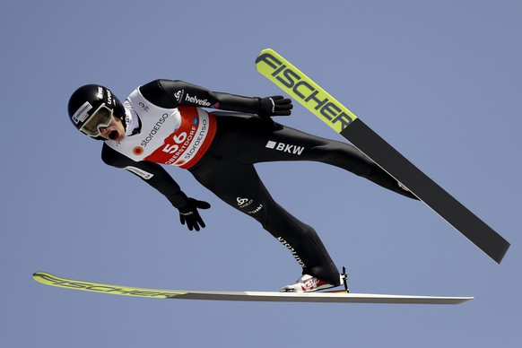 Gregor Deschwanden of Switzerland soars through the air during the ski jumping normal hill individual practice session for the upcoming FIS Nordic World Ski Championships in Oberstdorf, Germany, Wednesday, Feb. 24, 2021. (AP Photo/Matthias Schrader)