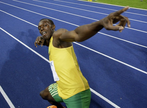Jamaica's Usain Bolt celebrates setting a new 100m World Record after the final of the Men's 100m during the World Athletics Championships in Berlin on Sunday, Aug. 16, 2009. (AP Photo/David J. Phillip)