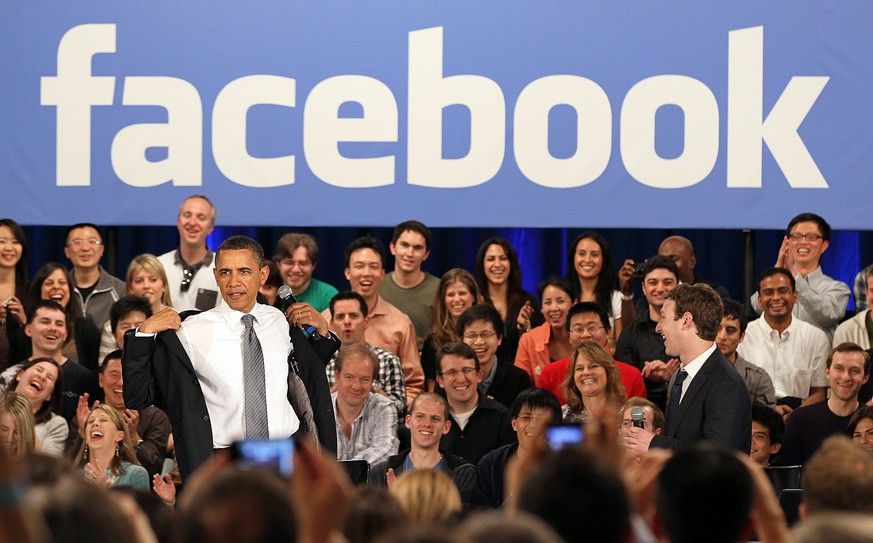 PALO ALTO, CA - APRIL 20: U.S. President Barack Obama (L) and Facebook CEO Mark Zuckerberg (R) greet the audience during a town hall style meeting at Facebook headquarters on April 20, 2011 in Palo Alto, California. Obama held the Facebook town hall to answer questions about the deficit and the economy.   Justin Sullivan/Getty Images/AFP