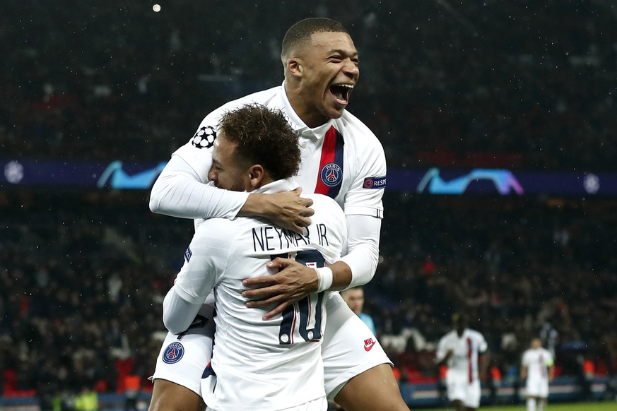 epa08063749 Paris Saint Germain's Neymar Jr (front) celebrates with Paris Saint Germain's Kylian Mbappe after scoring during the UEFA Champions League Group A soccer match between Paris Saint Germain and Galatasaray at the Parc des Princes stadium in Paris, France, 11 December 2019.  EPA/IAN LANGSDON
