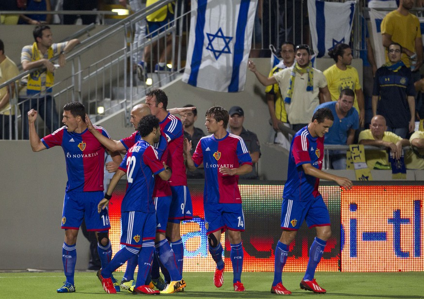 FC Basel Fabian Schaer , left, celebrates his opening goal against Maccabi Tel Aviv FC during the Champions League third qualifying round second leg soccer match at the Bloomfield stadium in Tel Aviv, Israel, Tuesday, Aug. 6, 2013. (AP Photo/Ariel Schalit)