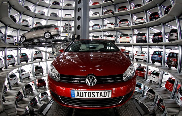 FILE PHOTO -  New Volkswagen models Golf Cabriolet and Passat are stored at the 'CarTowers' in the theme park 'Autostadt' next to the Volkswagen plant in Wolfsburg March 9, 2011.  REUTERS/Christian Charisius/File Photo                GLOBAL BUSINESS WEEK AHEAD   SEARCH GLOBAL BUSINESS 20 FEB FOR ALL IMAGES