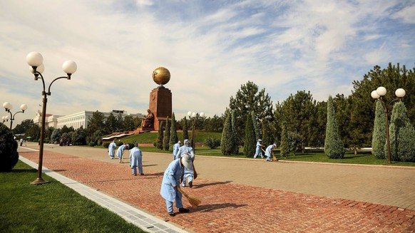 Municipal workers clean the area at Independence Square preparing to celebrate the Independence Day of the Republic of Uzbekistan in Tashkent, Uzbekistan, Monday, Aug. 29, 2016. Independence Day is celebrated on Sept. 1, annually since 1991 year. Uzbekistan's authoritarian president, Islam Karimov, has suffered a brain hemorrhage, his daughter said Monday as security forces surrounded the hospital caring for him. (AP Photo)