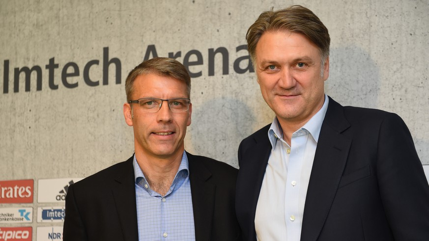 HAMBURG, GERMANY - OCTOBER 01:  Peter Knäbel poses for a picture with  Dietmar Beiersdorfer, chairman of Hamburger SV, after he was announced as the new director of professional football for Hamburger SV at Imtech Arena on October 1, 2014 in Hamburg, Germany.  (Photo by Stuart Franklin/Bongarts/Getty Images)