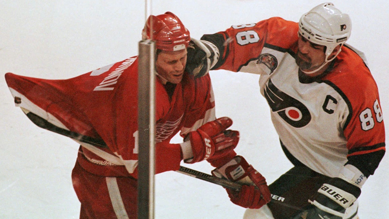 In this May 31, 1997 file photo Philadelphia Flyers Eric Lindros roughs up Detroit Red Wings Vladimir Konstantinov during the final minutes of Detroit's 4-2 victory over the Flyers in Game 1 of the Stanley Cup Finals, in Philadelphia.  Lindros returns Thursday night, Nov. 20, 2014, to the Wells Fargo Center when he is inducted into the Flyers Hall of Fame.  (AP Photo/Ron Frehm, File)