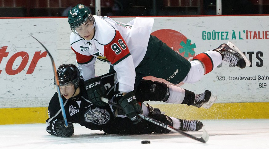 GATINEAU, CANADA - OCTOBER 24: Timo Meier #96 of the Halifax Mooseheads trips over Elie Berube #5 of the Gatineau Olympiques as the battle for the puck on October 24, 2014 at Robert Guertin Arena in Gatineau, Quebec, Canada.   Francois Laplante/Freestyle Photo/Getty Images/AFP == FOR NEWSPAPERS, INTERNET, TELCOS & TELEVISION USE ONLY ==