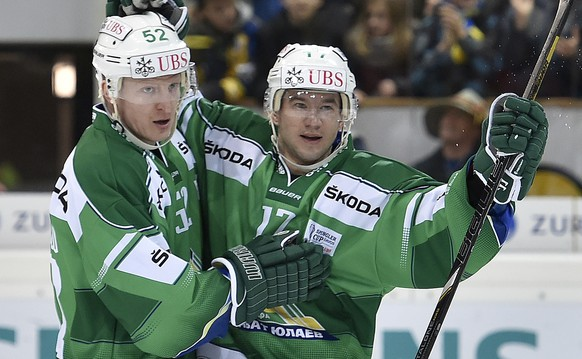 Ufa's Ivan Lekomsev, left, and Stanislav Golovanov celebrate their second scores during the game between Russia's HC Salavat Yulaev Ufa and Croatia's KHL Medvescal Zagreb at the 88th Spengler Cup ice hockey tournament in Davos, Switzerland, Monday, December 29, 2014. (KEYSTONE/Peter Schneider)